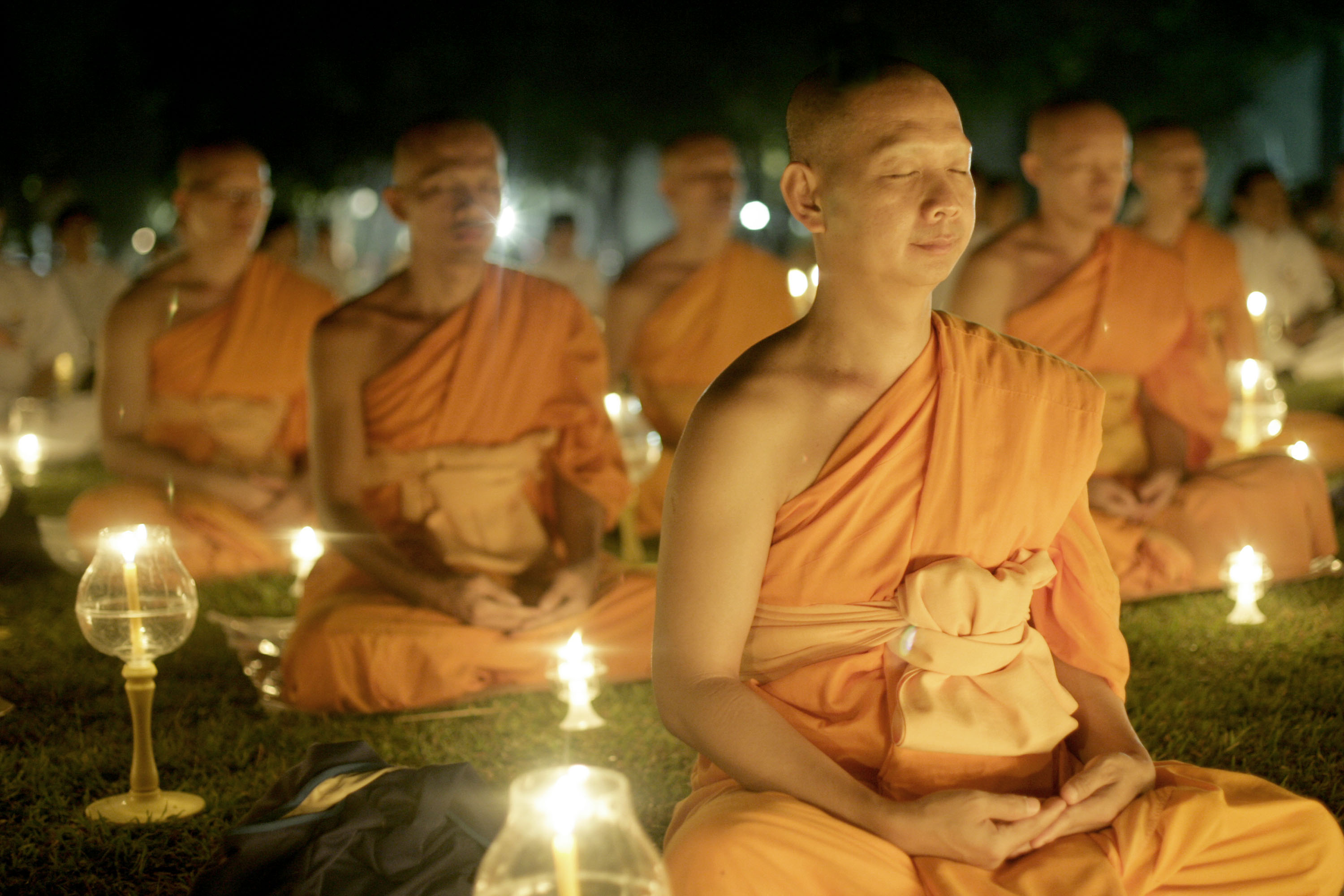 """MAGELANG, JAVA, INDONESIA - JUNE 1: Buddhist monks meditate at the yard of Borobudur temple, built between 750 and 842 AD, June 1, 2007 in Magelang, Central Java province, Indonesia. Buddhists in Indonesia celebrate Vesak Day or """"the day of Buddha's birth, his enlightenment and his reaching of nirvana"""" today. (Photo by Dimas Ardian/Getty Images)"""